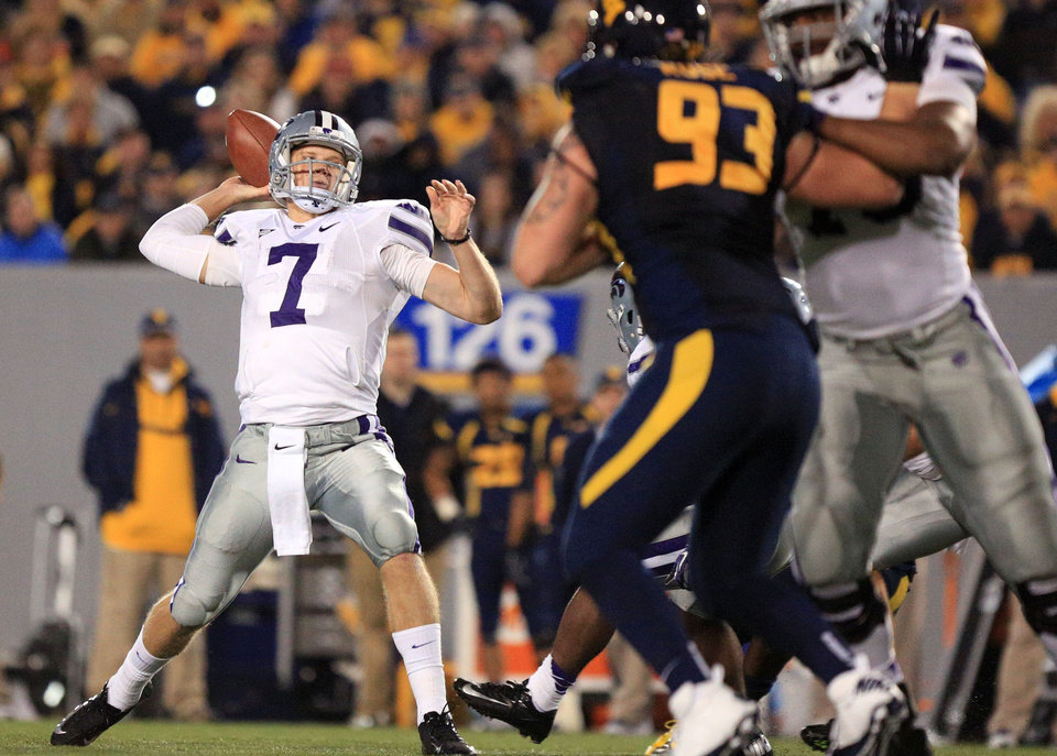 Photo -   Kansas State quarterback Collin Klein (7) prepares to pass during an NCAA college football game against West Virginia in Morgantown, W.Va., Saturday, Oct. 20, 2012. Kansas State won 55-14. (AP Photo/Christopher Jackson)