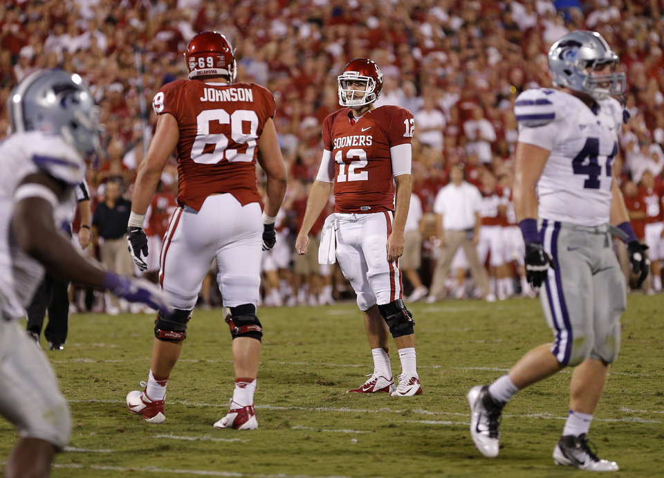 Oklahoma\'s Landry Jones (12) reacts after missing a two-point conversion during a college football game between the University of Oklahoma Sooners (OU) and the Kansas State University Wildcats (KSU) at Gaylord Family-Oklahoma Memorial Stadium, Saturday, September 22, 2012. Oklahoma lost 24-19. Photo by Bryan Terry, The Oklahoman