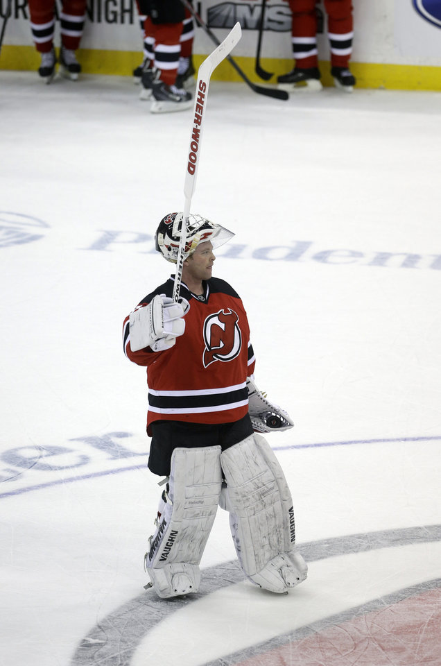 Photo - New Jersey Devils goalie Martin Brodeur waves to the crowd after an NHL hockey game against the Boston Bruins in Newark, N.J., Sunday, April 13, 2014. The Devils won 3-2. (AP Photo/Mel Evans)