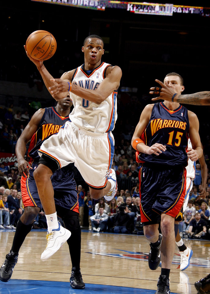 Photo - Oklahoma City's Russell Westbrook (0) looks to pass during the NBA game between the Oklahoma City Thunder and Golden State Warriors, Sunday, Jan. 31, 2010, at the Ford Center in Oklahoma City. Photo by Sarah Phipps, The Oklahoman