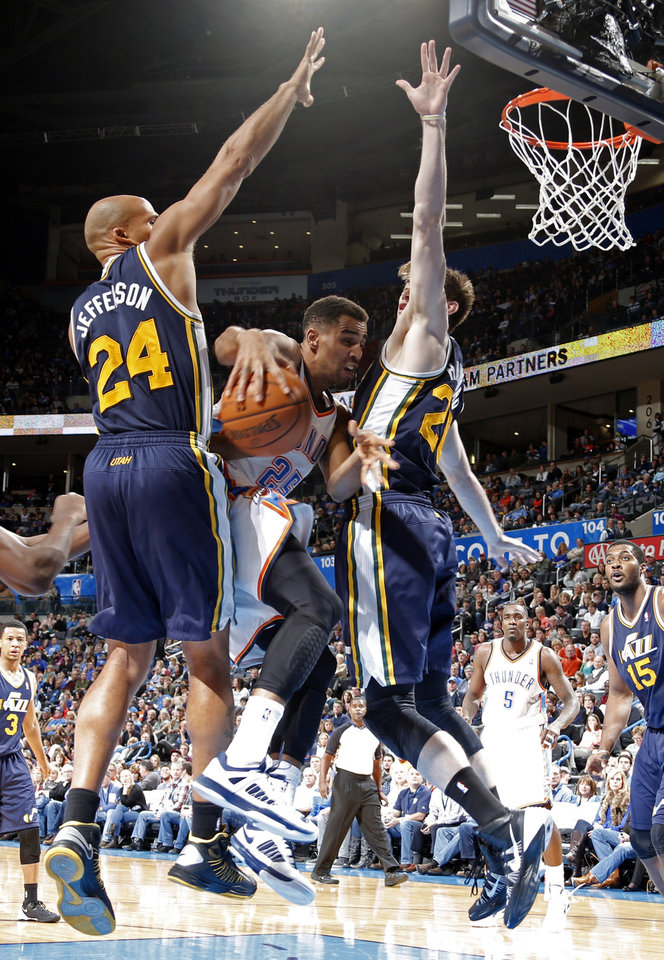 Photo - Oklahoma City's Thabo Sefolosha (25) tries to get through Utah's Richard Jefferson (24) and Gordon Hayward (20) during the NBA game between the Oklahoma City Thunder and the Utah Jazz at the Chesapeake Energy Arena, Sunday, Nov. 24, 2013. Photo by Sarah Phipps, The Oklahoman