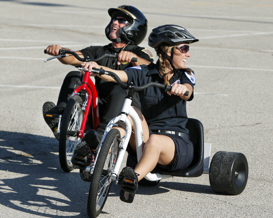 Photo -  Oklahoma Highway Patrol trooper Steve Johnson and EMSSTAT paramedic Melissa Denison finish a demonstration Saturday in Norman at The Ride, a race for children that raised funds for United Way. PHOTO BY STEVE SISNEY, THE OKLAHOMAN   STEVE SISNEY -