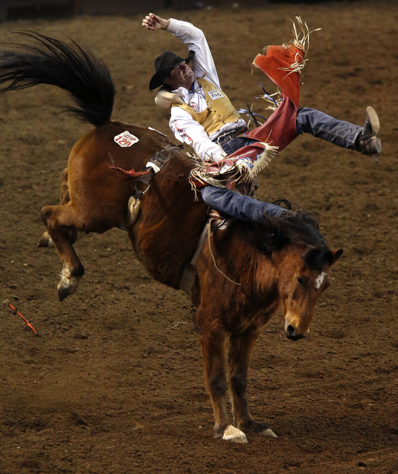 DV Fennell of Porum, Okla., competes in the bareback bronc competition in the International Finals Rodeo inside the State Fair Arena in Oklahoma City, Friday, Jan. 18, 2013. Photo by Bryan Terry, The Oklahoman