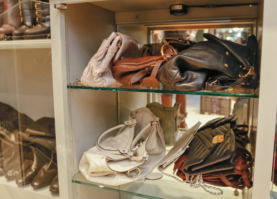 Instead of hanging clothes just anywhere in the closet, group similar items together -- pants with pants, tops with tops -- so you can just reach in and grab what you need. Photo by Chris Landsberger, The Oklahoman. CHRIS LANDSBERGER