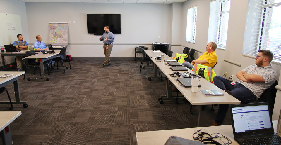 Photo -  Operations manager, Joel Garcia teaches class for the streetcar drivers. [Photo by Doug Hoke, The Oklahoman]