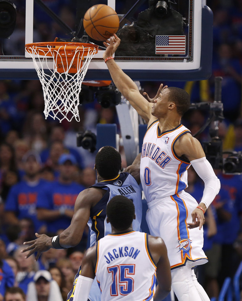 Photo - Oklahoma City's Russell Westbrook (0) blocks the shot of Memphis' Tony Allen (9) during Game 7 in the first round of the NBA playoffs between the Oklahoma City Thunder and the Memphis Grizzlies at Chesapeake Energy Arena in Oklahoma City, Saturday, May 3, 2014. Photo by Nate Billings, The Oklahoman