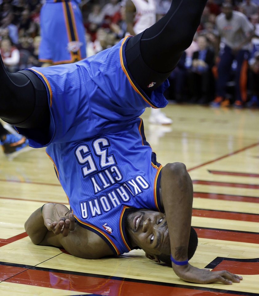 Photo -  Oklahoma City Thunder's Kevin Durant flips on his head after being fouled by Houston Rockets' Aaron Brooks during the first quarter of an NBA basketball game, Thursday, Jan. 16, 2014, in Houston. (AP Photo/David J. Phillip)
