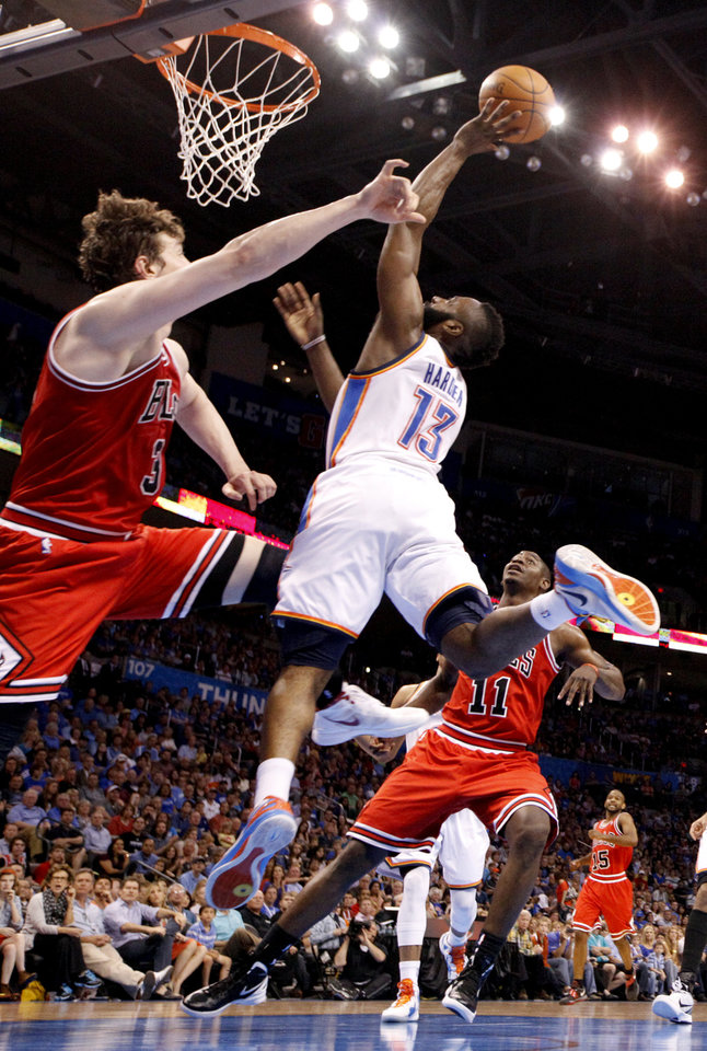 Oklahoma City's James Harden (13) shoots a lay up over Chicago's Omer Asik (3) during the NBA basketball game between the Chicago Bulls and the Oklahoma City Thunder at Chesapeake Energy Arena in Oklahoma City, Sunday, April 1, 2012. Photo by Sarah Phipps, The Oklahoman