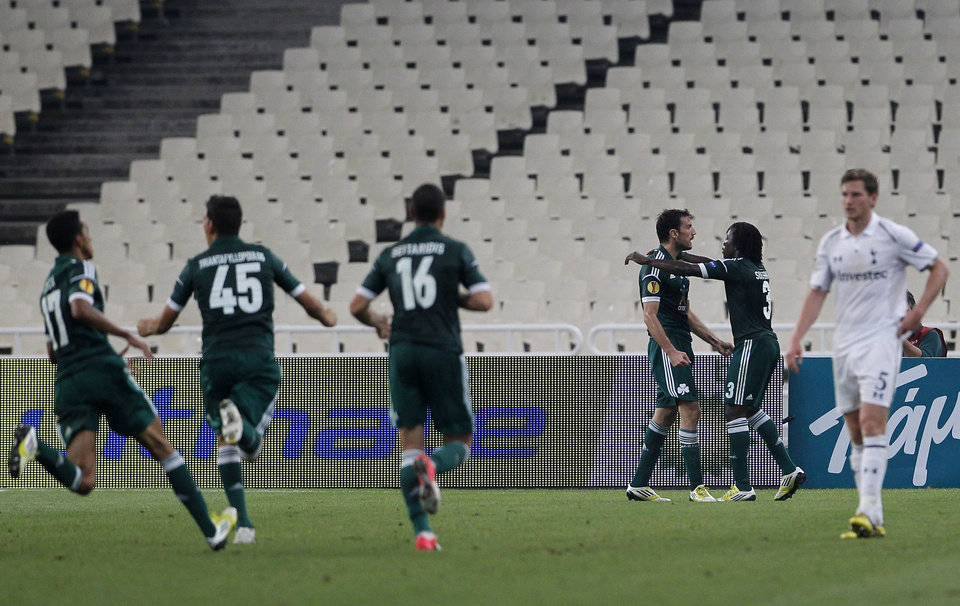 Photo -   Panathinaikos' Ibrahim Sissoko, second right, congratulates his teammate Toche, third right, after he score the first goal, during the Europa League group J soccer match against Tottenham Hotspur, at the Olympic stadium, in Athens, Thursday, Oct. 4, 2012. (AP Photo/Petros Giannakouris)