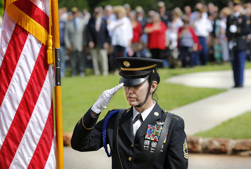 Photo - A member of the Governor's Honor Guard renders a slow and respectful salute before retrieving the American flag and retiring the colors at the end of the 45th Infantry Division Museum's Memorial Day Ceremony on Monday, May 30, 2016. Photo by Jim Beckel, The Oklahoman