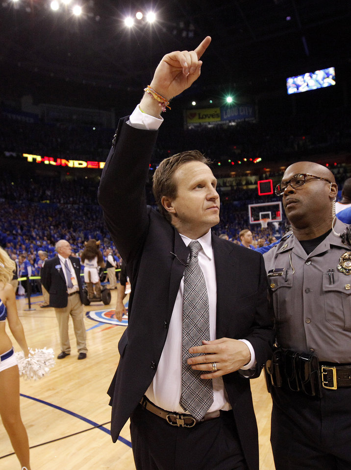 Photo - Oklahoma CIty coach Scott Brooks waves to the crowd after Game 5 in the second round of the NBA playoffs between the Oklahoma City Thunder and the L.A. Lakers at Chesapeake Energy Arena in Oklahoma City, Monday, May 21, 2012. Oklahoma City won 106-90. Photo by Bryan Terry, The Oklahoman