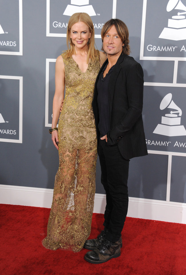 Photo - Nicole Kidman, left, and Keith Urban arrive at the 55th annual Grammy Awards on Sunday, Feb. 10, 2013, in Los Angeles.  (Photo by Jordan Strauss/Invision/AP)