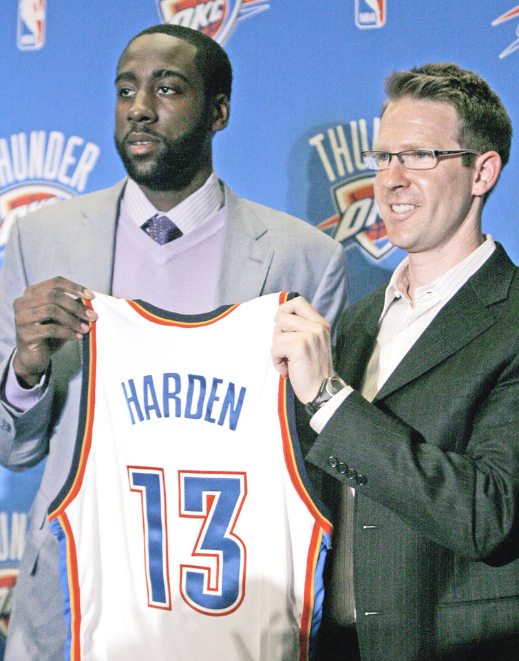 Photo - New Thunder guard James Harden holds his new jersey with Thunder general manager Sam Presti.  Photo by Sarah Phipps, The Oklahoman