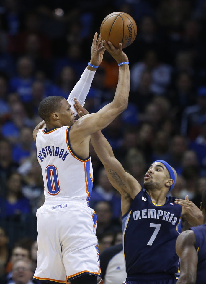 Oklahoma City Thunder guard Russell Westbrook (0) shoots over Memphis Grizzlies guard Jerryd Bayless (7) in the second quarter of an NBA basketball game in Oklahoma City, Thursday, Jan. 31, 2013. Oklahoma City won 106-89. (AP Photo/Sue Ogrocki)