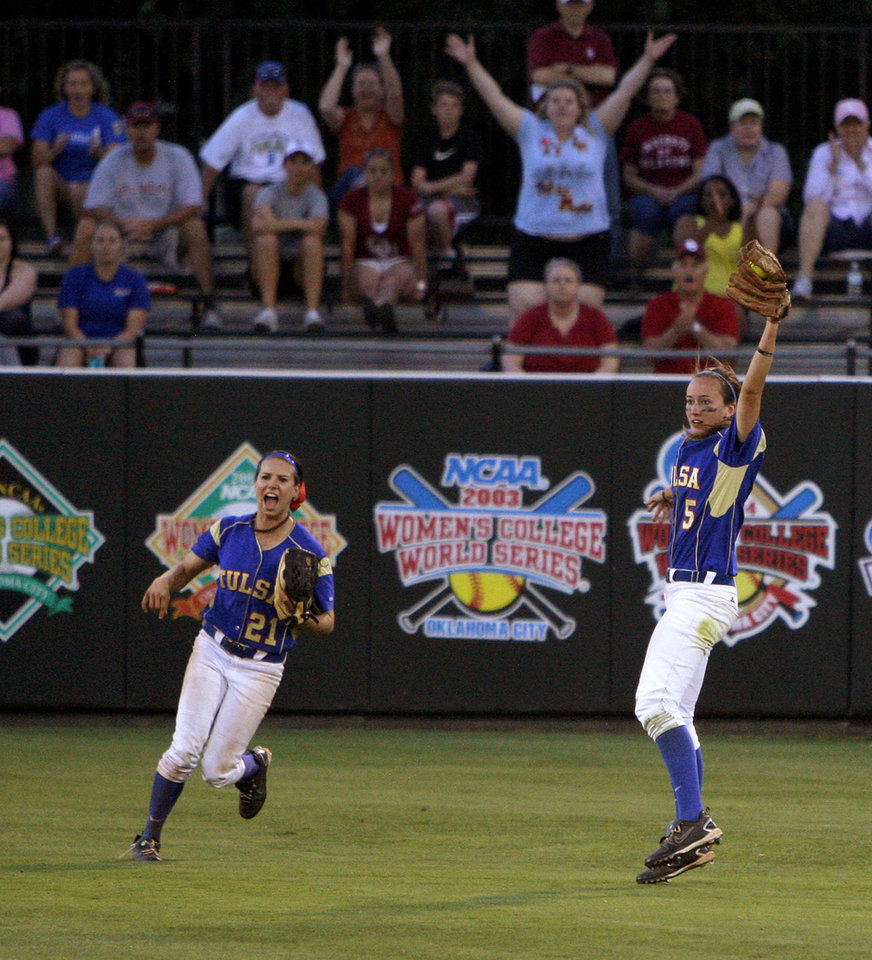 Photo - Tulsa's  Caitlin Everett, at right,  celebrates next to Jessica Stoelke after catching the final out against Oregon State in an the NCAA softball regional at the OU softball complex in Norman, Okla., Friday, May 18, 2012. Tulsa won 9-7. Photo by Bryan Terry, The Oklahoman