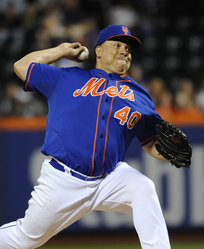 Photo - New York Mets starter Bartolo Colon pitches against the San Diego Padres in the first inning of a baseball game at Citi Field on Friday, June 13, 2014, in New York. (AP Photo/Kathy Kmonicek)