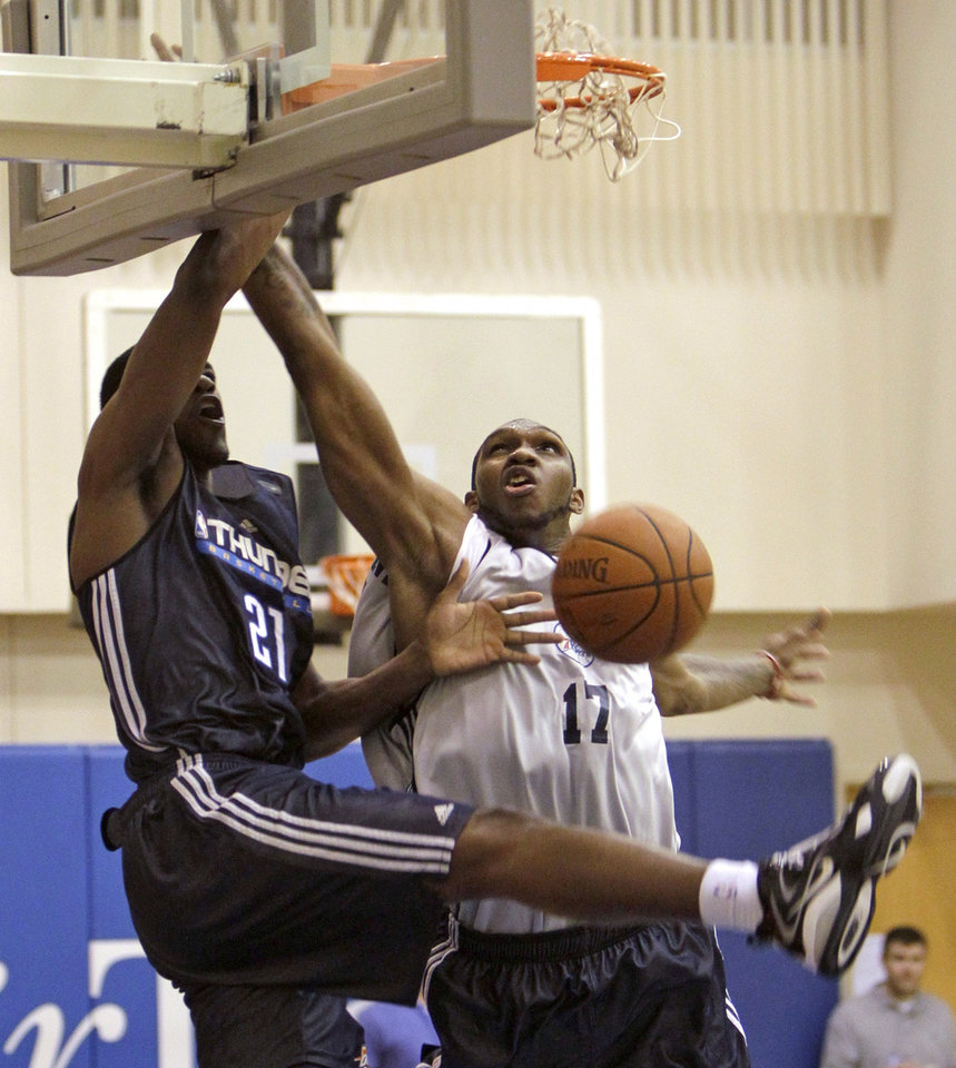 Oklahoma City Thunder\'s Latavious Williams (21) dunks the ball over Philadelphia 76ers\' Cedric Simmons (17) during the first half of an NBA summer league basketball game in Orlando, Fla., Wednesday, July 7, 2010. (AP Photo/John Raoux)