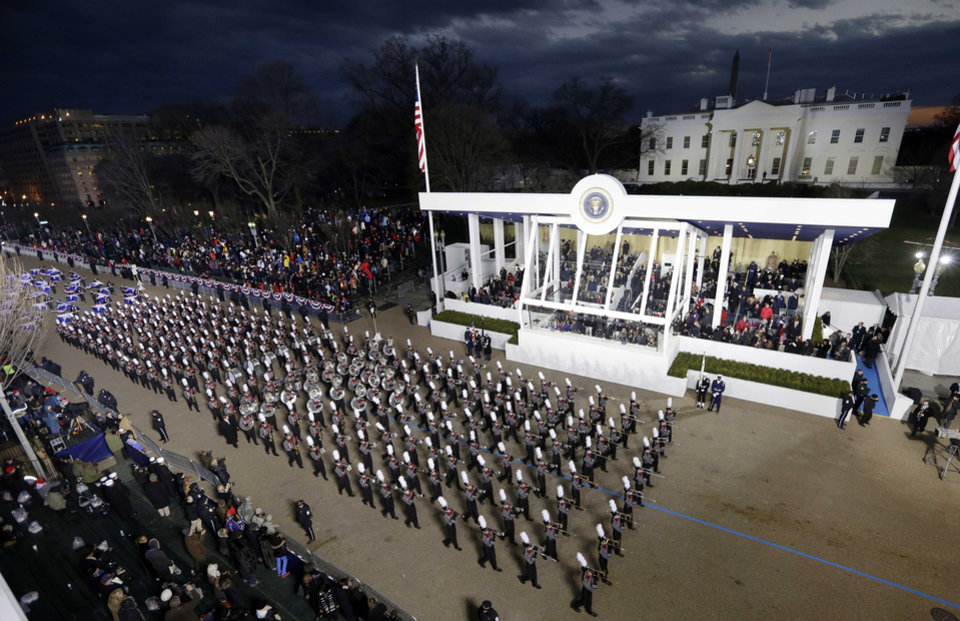 Photo - Dobyns-Bennett High School Band, in Tennessee, peform while passing the presidential box and the White House during the Inaugural parade, Monday, Jan. 21, 2013, in Washington. Thousands  marched during the 57th Presidential Inauguration parade after the ceremonial swearing-in of President Barack Obama. (AP Photo/Charlie Neibergall) ORG XMIT: DCMS177
