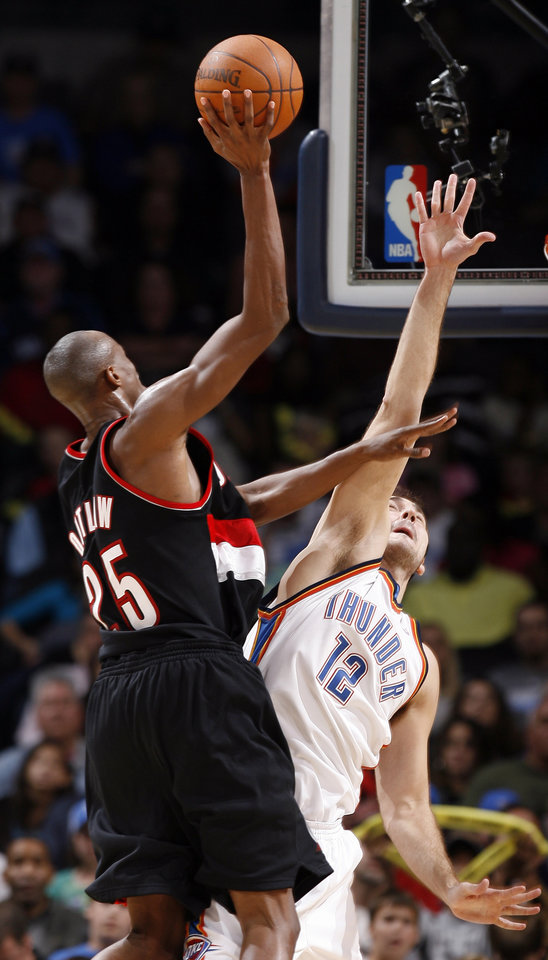 Photo - Oklahoma City's Nenad Krstic (12) defends against Portland's Travis Outlaw (25) during the NBA game between the Oklahoma City Thunder and the Portland Trail Blazers, Sunday, Nov. 1, 2009, at the Ford Center in Oklahoma City. Photo by Sarah Phipps, The Oklahoman