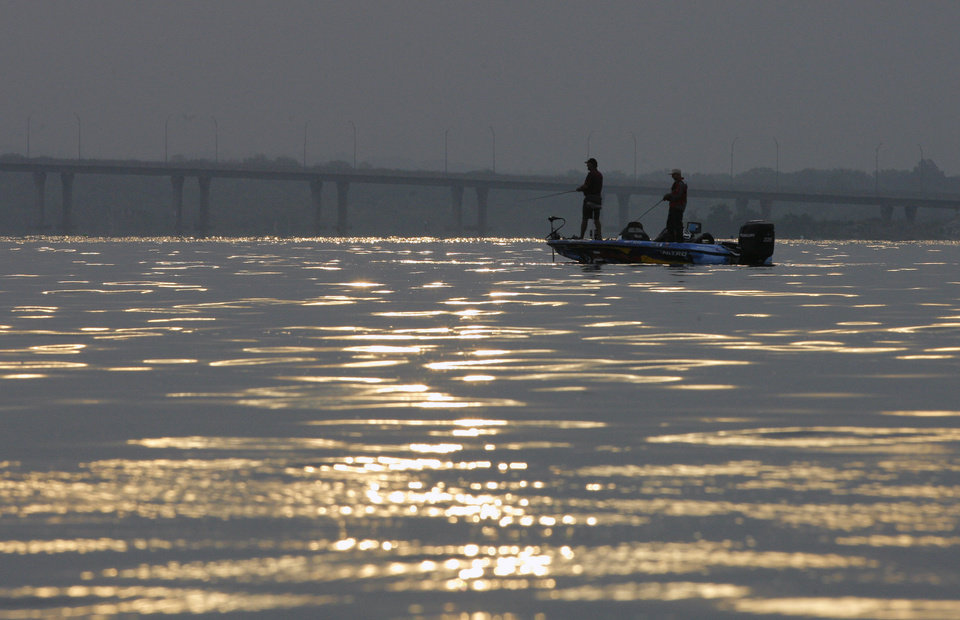 Photo -  Bass anglers fish near Sailboat Bridge on Grand Lake. The lake will be the site of an FLW bass tournament beginning Thursday.