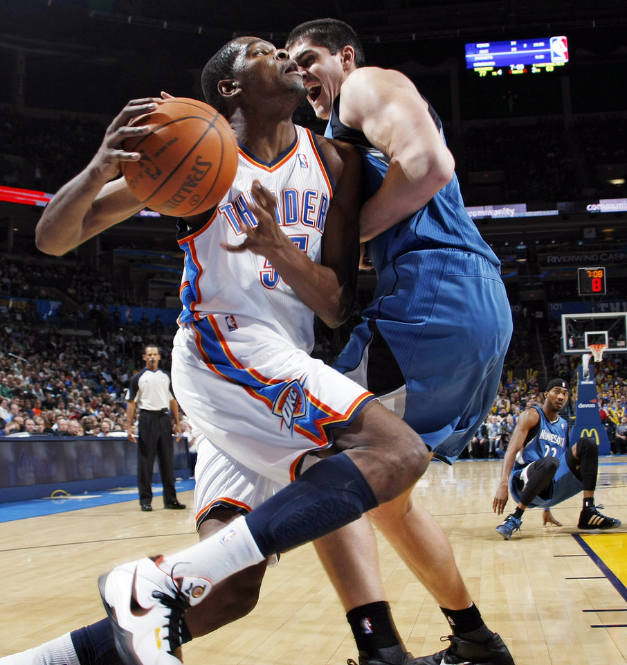 Photo - Oklahoma City's Kevin Durant (35) is fouled by Darko Milicic (31) of Minnesota during the NBA basketball game between the Minnesota Timberwolves and the Oklahoma City Thunder at the Oklahoma City Arena, Monday, November 22, 2010, in Oklahoma City. The Thunder won, 117-107. Photo by Nate Billings, The Oklahoman