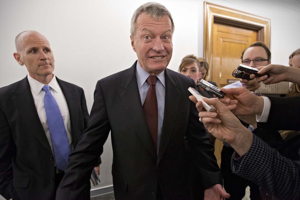 Photo - FILE - In this April 23, 2013, file photo, Senate Finance Committee Chairman Max Baucus, D-Mont., leaves his committee office at the Capitol, in Washington. Gun control forces are targeting Sens. Kelly Ayotte, Baucus and others as they struggle to persuade five senators to switch their votes and revive the rejected effort to expand background checks to more firearms buyers.  (AP Photo/J. Scott Applewhite, File)