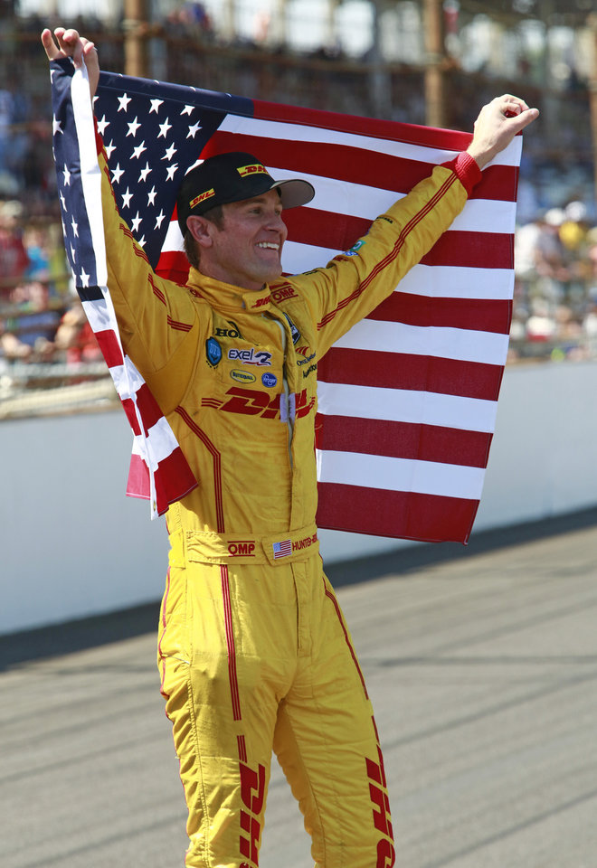 Photo - Ryan Hunter-Reay celebrates after winning the 98th running of the Indianapolis 500 IndyCar auto race at the Indianapolis Motor Speedway in Indianapolis, Sunday, May 25, 2014. (AP Photo/R Brent Smith)