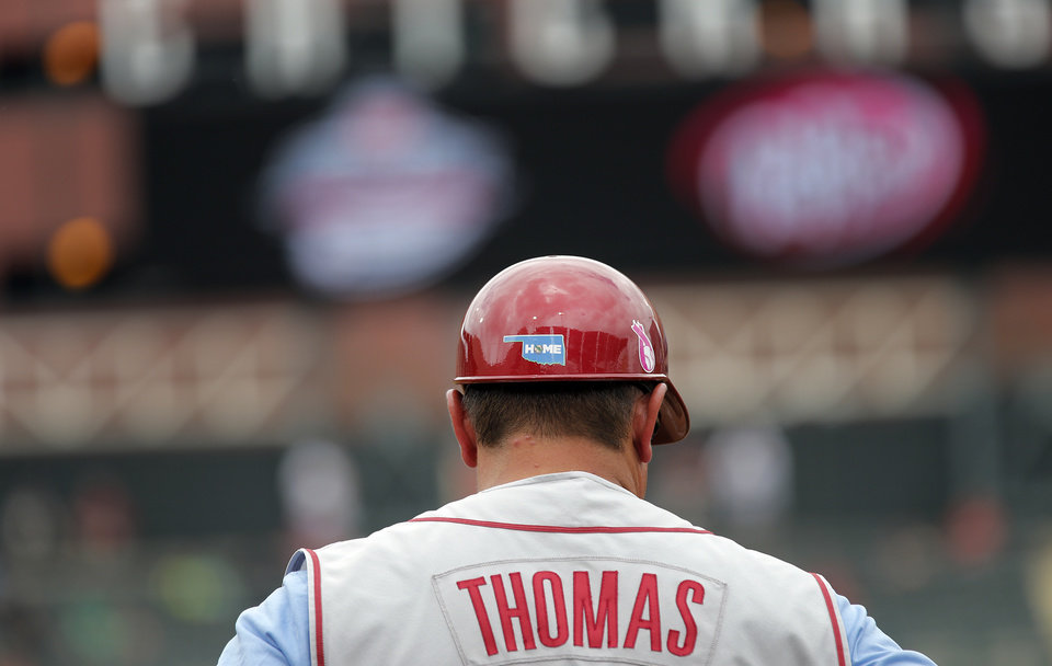 Oklahoma assistant coach Aric Thomas wears a blue Oklahoma 'Home' sticker on his helmet in the Big 12 Championship baseball game between the University of Kansas Jayhawks (KU) and the University of Oklahoma Sooners (OU) at the Chickasaw Bircktown Ballpark on Sunday, May 26, 2013 in Oklahoma City, Okla. The sticker is for the victims of the Moore tornado.   Photo by Chris Landsberger, The Oklahoman