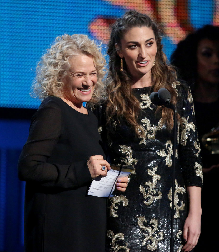Photo - Carole King, left, and Sara Bareilles presents the award for song of the year at the 56th annual Grammy Awards at Staples Center on Sunday, Jan. 26, 2014, in Los Angeles. (Photo by Matt Sayles/Invision/AP)