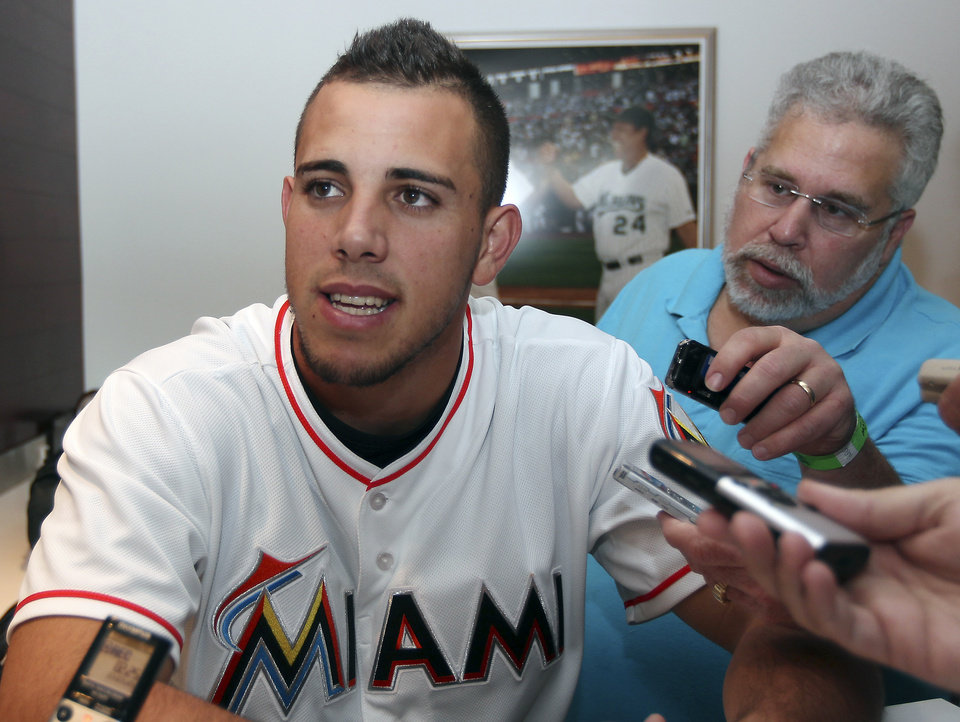 Photo - Miami Marlins pitcher Jose Fernandez, 2013 National League Rookie of the Year, talks to the media at the Marlins Winter Warm-Up on Saturday, Feb. 15, 2014, in Miami, Fla. (AP Photo/El Nuevo Herald, David Santiago)