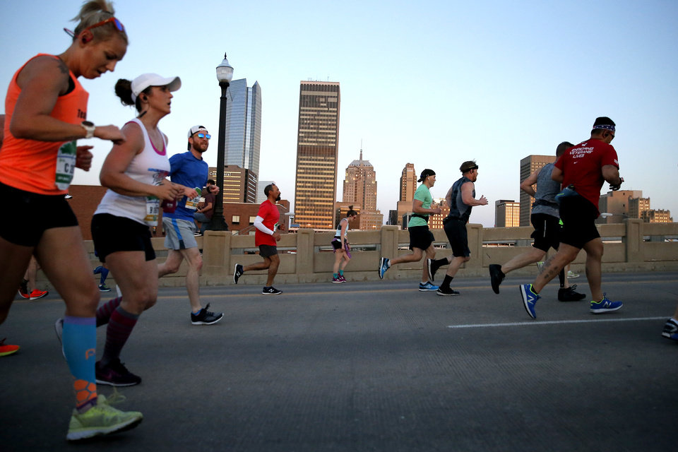Photo - Runners make their way north on the Dr. G.E. Finely Bridge during the Oklahoma City Memorial Marathon in Oklahoma City, Sunday, April 29, 2018. Photo by Bryan Terry, The Oklahoman