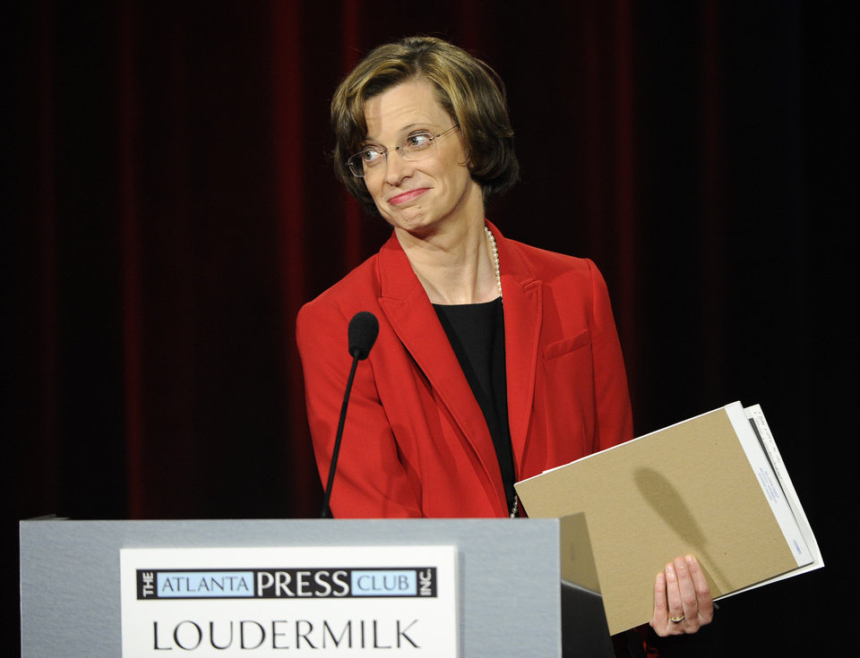 Photo - Democratic senatorial candidate Michelle Nunn, the former CEO of Points of Light from Atlanta, participates in a debate at the Georgia Public Broadcasting studio, Sunday, May 11, 2014, in Atlanta. (AP Photo/David Tulis)