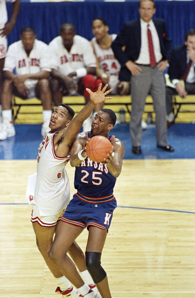 Kansas Danny Manning goes for the basket around Oklahoma's Stacey King during the first of the Championship game of the final four tournament in Kansas City, Monday, April 4, 1988. (AP Photo/Susan Ragan) <strong>Susan Ragan - ASSOCIATED PRESS</strong>