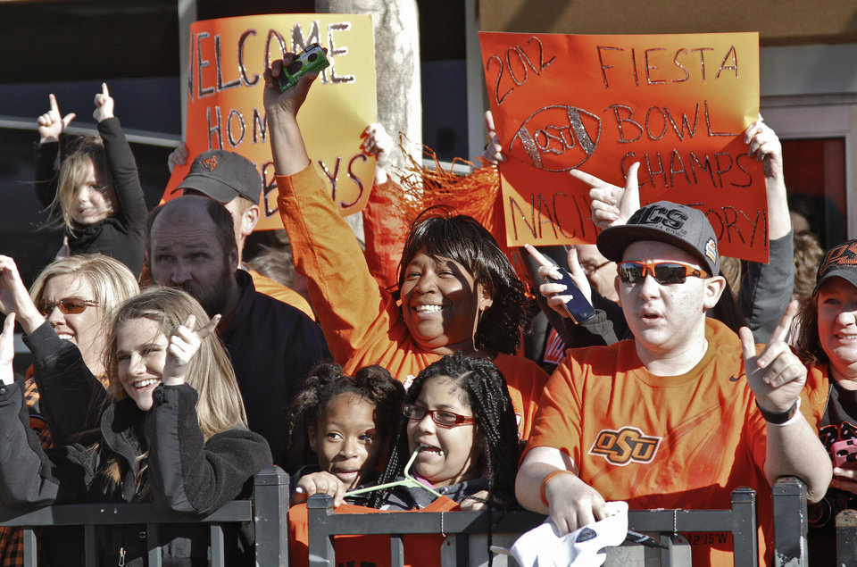 Oklahoma State fans cheer on their team as the Oklahoma State University college football team arrives at the Stillwater Airport from their BCS Fiesta Bowl win on Tuesday, Jan. 3, 2012, in Stillwater, Okla. The Cowboys defeated Stanford 41-38 in overtime. Photo by Chris Landsberger, The Oklahoman