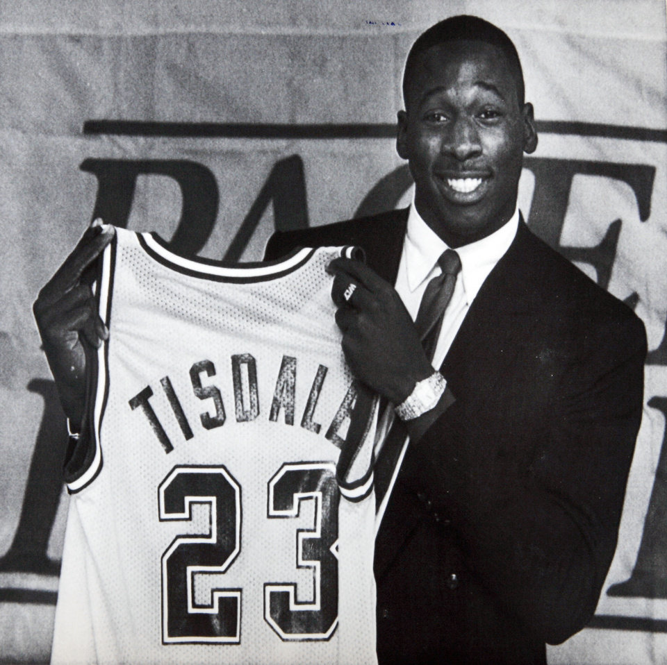 Photo - Former OU basketball player Wayman Tisdale.  INDIANAPOLIS, Oct. 10-- WAYMAN SIGNS--Wayman Tisdale, the Indiana Pacers number one draft choice, holds up his Pacer jursey after he signed his contract with the team Thursday in Indianapolis. Tisdale, the Oklahoma University all-American, signed a four-year contract with the Pacers after weeks of negoations. (AP Laserphoto) 1985. Photo taken 10/10/1985, Photo published 10/11/1985 in The Daily Oklahoman. ORG XMIT: KOD