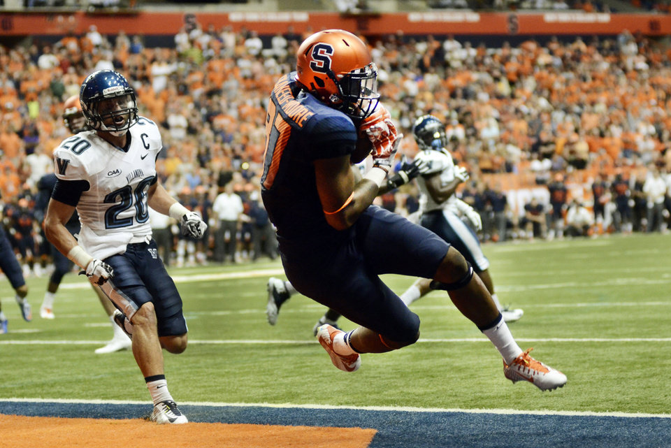 Photo - Syracuse's Kendall Moore catches a pass in the second overtime against Villanova during an NCAA college football game in Syracuse, N.Y., Friday, Aug. 29, 2014. Syracuse won 27-26. (AP Photo/Heather Ainsworth)