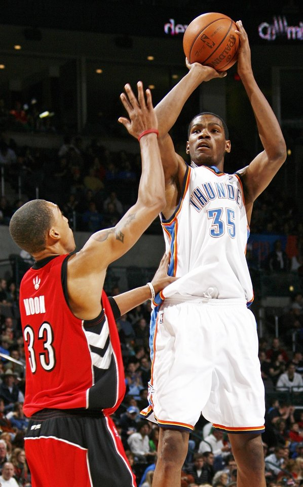 Oklahoma City's Kevin Durant shoots over Jamario Moon of Toronto in the second half of the NBA basketball game between the Toronto Raptors and the Oklahoma City Thunder at the Ford Center in Oklahoma City, Friday, Dec. 19, 2008. The Thunder won, 91-83. BY NATE BILLINGS, THE OKLAHOMAN