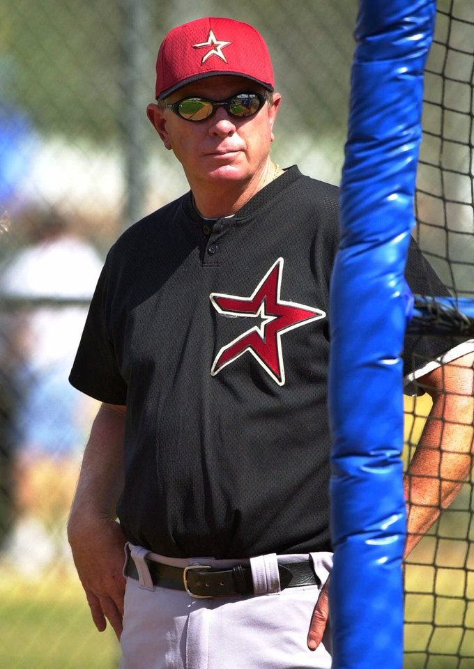 Photo - RESIGN, RESIGNATION: FILe-- Houston Astros manager Larry Dierker watches his team practice during their first workout of the spring training season in Kissimmee, Fla., in this Feb. 16, 2001 photo. Dierker resigned as  manager on Thursday, Oct. 18, 2001. (AP Photo/Charles Krupa)