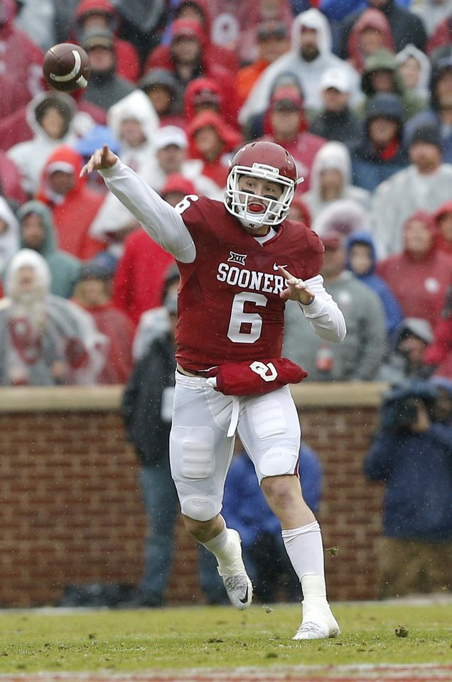 Photo - Oklahoma's Baker Mayfield (6) throws a pass in the first quarter during the Bedlam college football game between the Oklahoma Sooners (OU) and the Oklahoma State Cowboys (OSU) at Gaylord Family - Oklahoma Memorial Stadium in Norman, Okla., Saturday, Dec. 3, 2016. OU won 38-20. Photo by Sarah Phipps, The Oklahoman