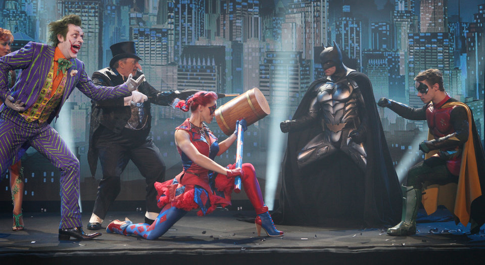 Photo - Nick Court, who plays Batman, centre right, and Michael Pickering who plays Robin, far right, perform on stage to launch the Batman Live Tour in central London, Tuesday 12 April 2011, which tours arenas across the UK and Europe beginning in Summer 2011, and arrives in North America in August 2012. Combining acrobatics, stunt work and illusions, the adventures of Batman and Robin are brought to life on stage for the first time in the characters history.(AP Photo/Joel Ryan)