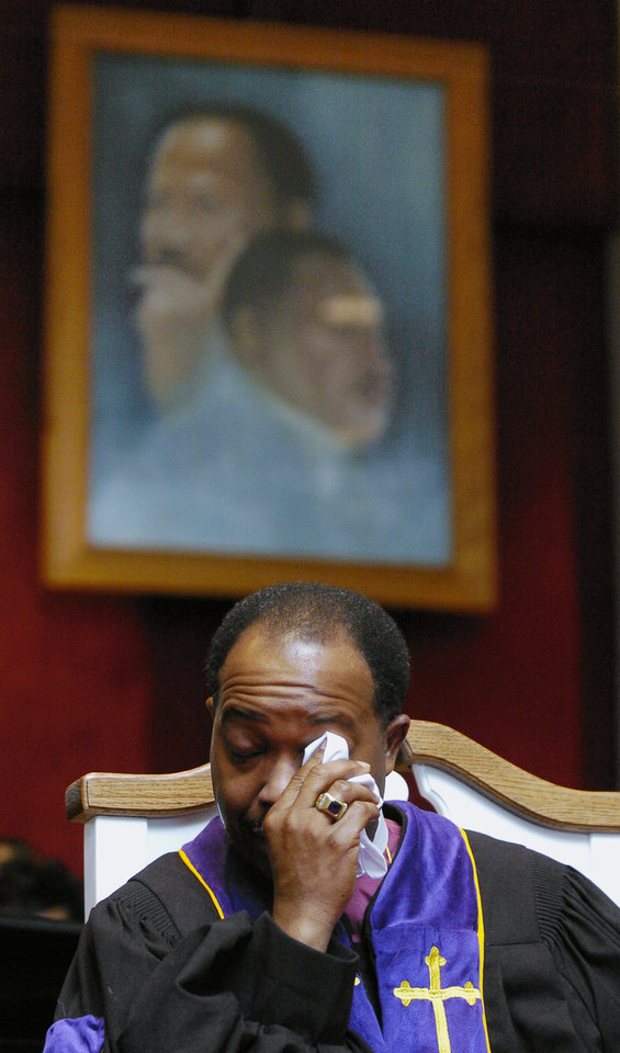 Photo - OKLAHOMA CITY, OK, SUNDAY, JANUARY 16, 2005     Dr. Henry M. Williamson, Sr., 52nd Bishop of the Christian Methodist Episcopal Church in Los Angeles, CA, wipes a tear after hearing Clara Luper's reflections on the civil rights movement.  Williamson was the main speaker during a