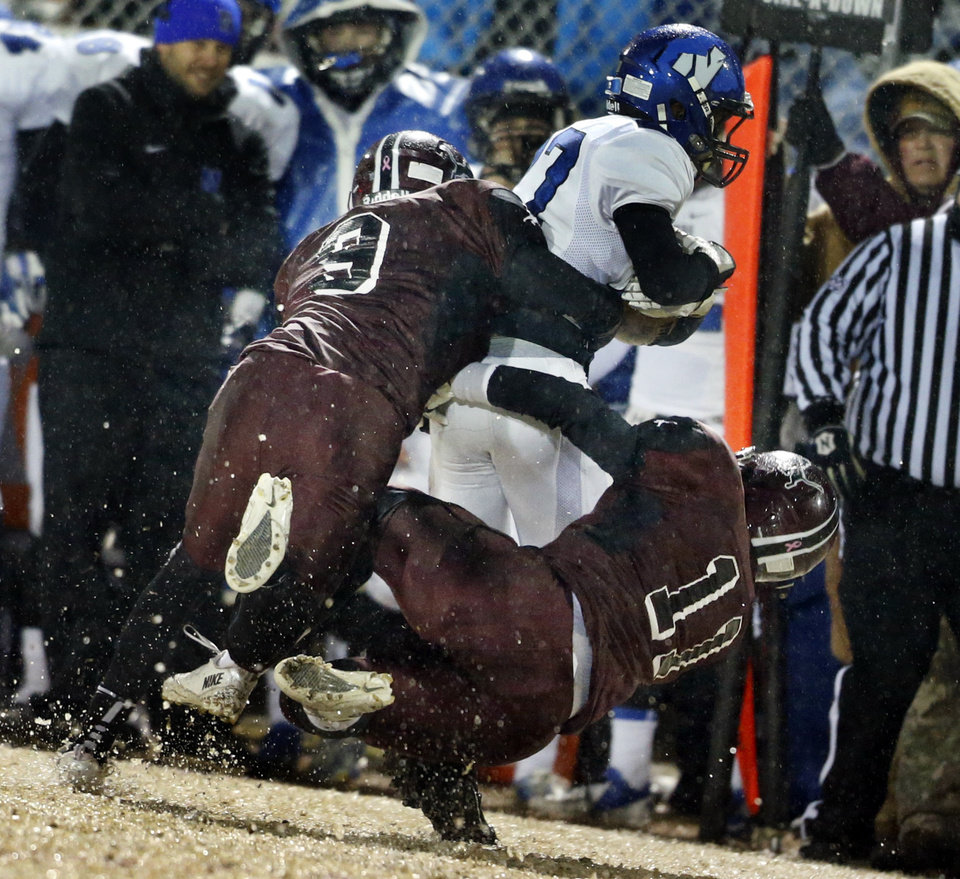 Photo - Newcastle's Brandon Smith is tackled by Jalan Daniels (9) and Logan Wright as Newcastle plays Blanchard in Class 3A high school football playoffs on Friday, Nov. 22, 2013, in Blanchard, Okla. Photo by Steve Sisney, The Oklahoman