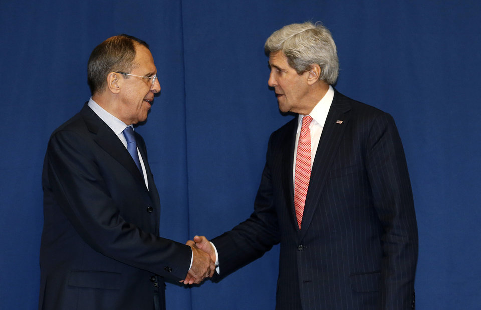 Photo - Secretary of State John Kerry shakes hands with Russian Foreign Minister Sergey Lavrov during a meeting to discuss the Ukraine crisis, Thursday, March 6, 2014, at the Conference on International Support to Libya, in Rome. It is the second meeting in as many days between Kerry and Lavrov, who met in Paris on Wednesday to talk about the crisis over the crisis in Ukraine's Crimea Peninsula. (AP Photo/Kevin Lamarque, Pool)