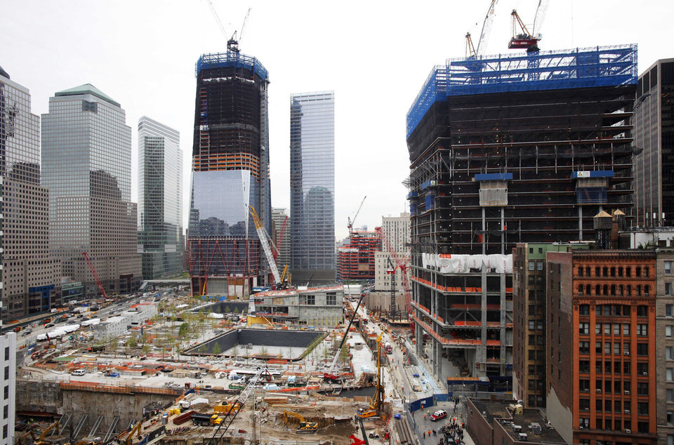 Photo - Work continues at the World Trade Center site and the Freedom Tower, center left, in New York on Monday, May 2, 2011. On Sunday, President Barack Obama announced Osama bin Laden was killed by U.S. forces in Pakistan. At right is 4 World Trade Center. (AP Photo/Mark Lennihan) ORG XMIT: NYML112
