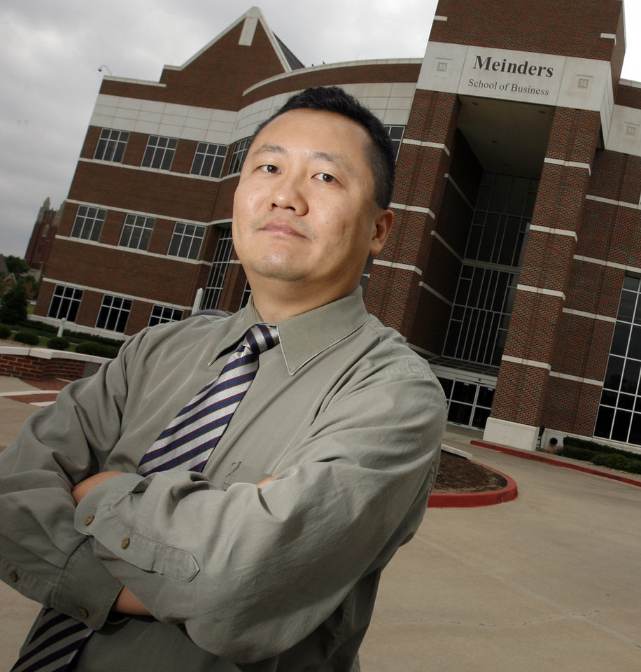Photo - ANNIVERSARY: James Ma, an assistant finance professor at Oklahoma City University, poses for a photo at the OCU Meinders School of Business in Oklahoma City, Wednesday, june 3, 2009. For story on the Tiananmen Square events of 1989. Photo by Nate Billings, The Oklahoman  ORG XMIT: KOD
