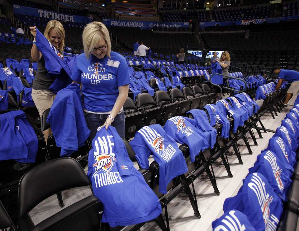 Kelly Curry (left) and Khrystian Hembree put t-shirts on chairs in preparation for the first game of the NBA basketball finals at the Chesapeake Arena on Tuesday, June 12, 2012 in Oklahoma City, Okla.  Photo by Steve Sisney, The Oklahoman