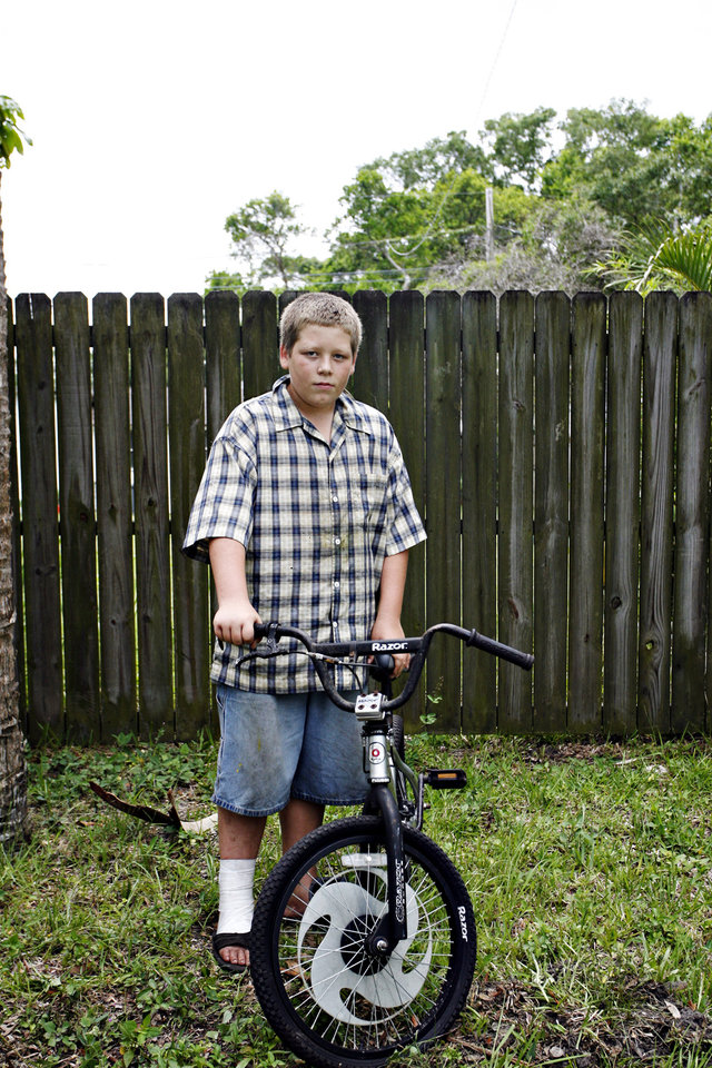 Photo -   Kole Price, 13, awho Anthony Giancola reportedly ran off the road, poses for a portrait Friday, June 22, 2012, in Lealman, Fla. Authorities said Giancola, an ex-Tampa Bay-area middle school principal who lost his job over a drug arrest five years ago, went on a rampage Friday, stabbing several people, killing at least two. Authorities said there were 11 victims in all, and several are being treated at area hospitals for injuries ranging from minor to life-threatening. (AP Photo/Tampa Bay Times, Melissa Lyttle) TAMPA OUT; CITRUS COUNTY OUT; PORT CHARLOTTE OUT; BROOKSVILLE HERNANDO TODAY OUT