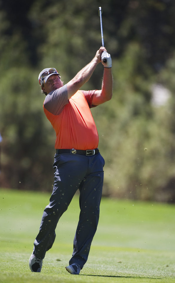 Photo - Former NHL player Jeremy Roenick hits from the fairway during the American Century Championship golf tournament Saturday, July 19, 2014, at Edgewood Tahoe Golf Course in Stateline, Nev. (AP Photo/Reno Gazette-Journal, Hilary Swift)