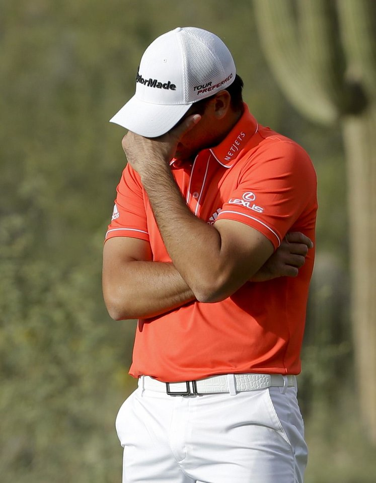 Photo - Jason Day, of  Australia, reacts after missing the winning putt on the 18th hole in his championship match against Victor Dubuisson, of France, during the Match Play Championship golf tournament on Sunday, Feb. 23, 2014, in Marana, Ariz. (AP Photo/Ted S. Warren)