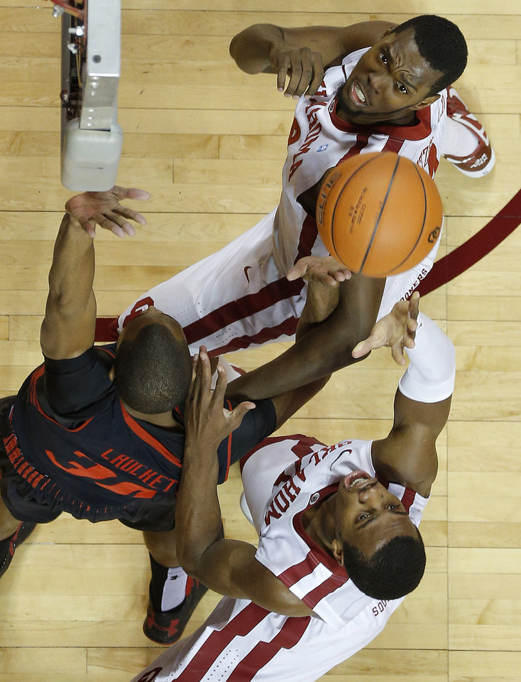 Oklahoma's Buddy Hield, bottom, puts up a shot as Oklahoma's Andrew Fitzgerald watches beside Texas Tech's Jaye Crockett during an NCAA college basketball game between the University of Oklahoma and Texas Tech University at Lloyd Noble Center in Norman, Okla., Wednesday, Jan. 16, 2013. Photo by Bryan Terry, The Oklahoman